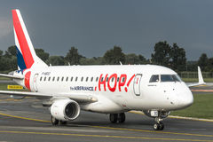 Embraer E145 HOP! By Air France. TORINO CASELLE AIRPORT - JULY 10, 2017: Embraer E145 HOP! By Air France, landed at Turin Airport, Italy, just after a heavy Stock Photos