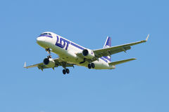 The Embraer E-170 (SP-LIN) LOT Polish Airlines is landing in Pulkovo airport Stock Photography