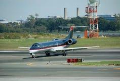 Embraer ERJ-145 passenger jet. Embraer ERJ jet on runway after landing Stock Photography