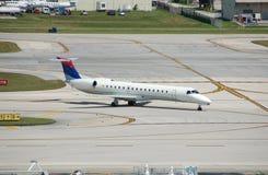Embraer ERJ-145 regional jet. Small passenger jet airplane on runway Stock Images