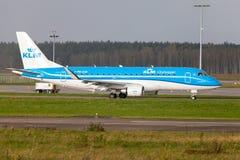 Embraer ERJ-175 from airline KLM lands on international airport. LANGENHAGEN / GERMANY - OCTOBER 28, 2017: Embraer ERJ-175 from airline KLM lands on Royalty Free Stock Images