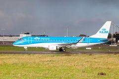 Embraer ERJ-175 from airline KLM lands on international airport. LANGENHAGEN / GERMANY - OCTOBER 28, 2017: Embraer ERJ-175 from airline KLM lands on Stock Photos