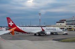 Embraer ERJ-190LR of Helvetic Airways landed at Geneva airport. GENEVA, SWITZERLAND - JUNE 25, 2017: Embraer ERJ-190LR of Helvetic Airways landed at Geneva Royalty Free Stock Image