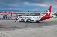Embraer ERJ-190LR of Helvetic Airways landed at Geneva airport. GENEVA, SWITZERLAND - JUNE 25, 2017: Embraer ERJ-190LR of Helvetic Airways landed at Geneva Royalty Free Stock Photography