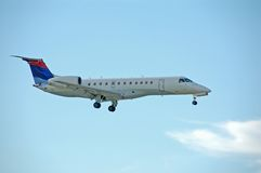 EMbraer ERJ regional jet. Small jetliner for regional service before landing Royalty Free Stock Photo