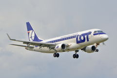 Embraer ERJ 175 STD. This is a view of LOT Polish Airlines plane Embraer ERJ 175 STD registered as SP-LIL on the Warsaw Chopin Airport. September 16, 2015 Stock Photography