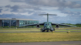 Embraer KC-390 transport aircraft. Farnborough, UK - 16th July 2016: An Embraer KC-390 transport aircraft of Brazilian Airforce awaits takeoff Stock Images