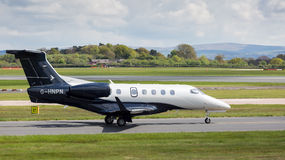 Embraer Phenom 300 preparing to take off at Manchester Airport. MANCHESTER AIRPORT - MAY 1st 2017: Embraer Phenom 300 preparing to take off at Manchester Airport royalty free stock photography