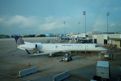 Embraer 135 United  Airlines. A Embraer 135 United  Airlines airplane  taxiing to the gate at Houston International Airport Stock Photos