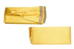 Embrague amarillo con el arco y los diamantes fotografía de archivo