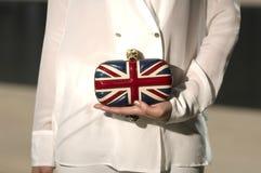 Embrague británico de la bandera celebrado disponible Fotografía de archivo