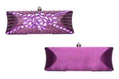 Embrague púrpura con las gemas en un fondo blanco fotos de archivo libres de regalías
