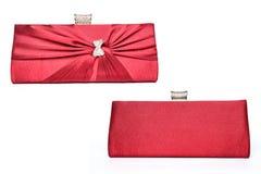 Embrague rojo con el arco del diamante imagen de archivo libre de regalías