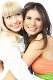 embrassant les amis deux heureux Images libres de droits