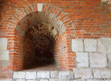 An embrasure in the ancient wall of the fortress. Medieval wall from red brick and white limestone with embrasure St. Nicholas Gate Tower of the Zaraysk Kremlin royalty free stock images