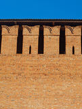 Embrasure in the defense wall. Of red bricks of ancient city stock photo