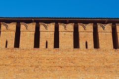 Embrasure in the defense wall. Of red bricks of ancient city royalty free stock photography