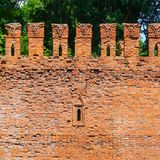 Embrasure in the defense wall of red bricks Royalty Free Stock Photos