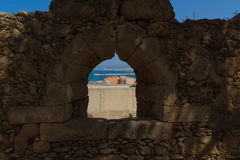 The embrasure in Fortezza, Rethymno, Greece. The Fortezza & x28;from Italian for & x22;fortress& x22;& x29; is the citadel of the city of Rethymno in Crete royalty free stock photo