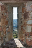 Embrasure in the wall of fortress. Bosa town in Sardinia royalty free stock photography