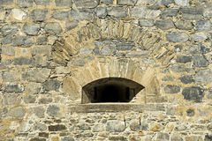 Embrasure in the wall a fortress Royalty Free Stock Photo