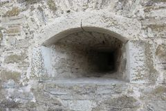 Embrasure in the watchtower of the old fortress. This is an interesting place to travel stock image