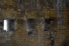 Embrasures in the wall of ruined castle Royalty Free Stock Photo