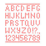 Embroided by cross stitch english alphabet with numbers and symbols  on white background. Royalty Free Stock Photos