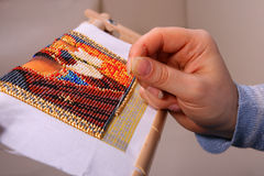 Embroidered in beads picture Royalty Free Stock Images