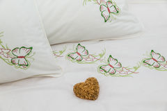 Embroidered bedding Stock Photo