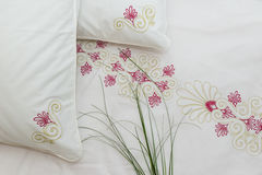 Embroidered bedding. Traditional embroidered bedding with green-stuff  on it Royalty Free Stock Image