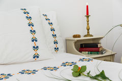 Embroidered bedding Stock Image
