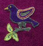 Embroidered bird. Square of patchwork with applique and embroidered bird on a branch with leaves. Demonstrates a variety of techniques. Created by the Royalty Free Stock Photos