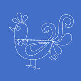 Embroidered bird on blue background Royalty Free Stock Images