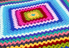 Embroidered blanket. Forming a background color Stock Photo