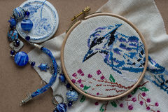 Embroidered blue bird, blue beads and elements Stock Image