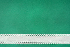 Embroidered border. White embroidered border on a green background royalty free stock images