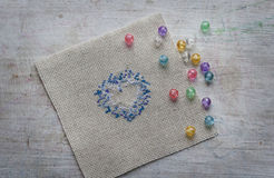 Embroidered Christmas heart and beads Royalty Free Stock Photos