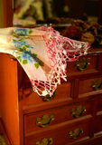 Embroidered Cloth. A jewelry chest with a handkerchief on top of it Royalty Free Stock Photo
