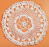 Embroidered crochet lace flower ornament placemat. Vintage knitting craftsmanship - embroidered crochet lace flower ornament of placemat Stock Photography