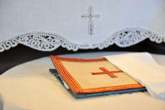 Embroidered cross. Embroidered cross in orange beige canvas Stock Image
