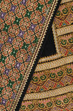 Embroidered decorative design. Embroidered handmade design with geometric and flower-like decorative shapes stock photography