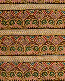 Embroidered decorative design. Embroidered handmade design with geometric and flower-like decorative shapes royalty free stock photo