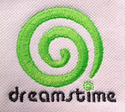 Embroidered dreamstime logo. Camera shot on embroidered dreamstime logo stock photo