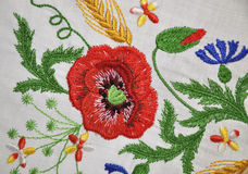 Embroidered element products. Embroidered element of floral pattern on white fabric products Royalty Free Stock Photo