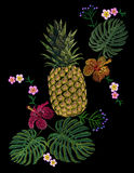 Embroidered exotic yellow pineapple fruit monstera leaves hibiscus flower.   Royalty Free Stock Photo