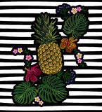 Embroidered exotic yellow pineapple fruit monstera leaves hibiscus flower.   Stock Images