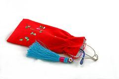 Embroidered Eyeglass Holder. Traditional Chinese red embroidered eyeglass drawstring bag or holder with a blue tassel Stock Photography