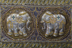 Embroidered fabric with beads, ornaments, two elephants in oriental style Stock Photos