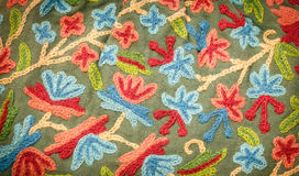 Embroidered fabrics Stock Images